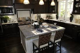 This Stunning Kitchen Brings Together Dark Wooden Cabinets That Correspond  With The Beautiful Hardwood Flooring.