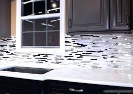 black and white backsplash black white and gray kitchen tile backsplash white cabinets black countertops