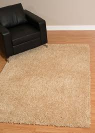 enjoy a cozy floor covering from the vibrant columbia collection the fluffy rug will brighten up any living space with its natural beige color tone