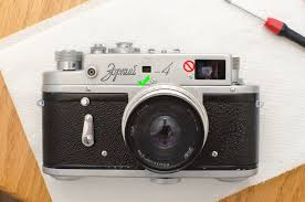 the to the left of the main viewfinder window hides the horizontal rangefinder adjustment on