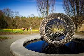 visitors to tower hill botanic garden are seeing the property in a whole new light this spring thanks to the installation of a kinetic sculpture exhibit by