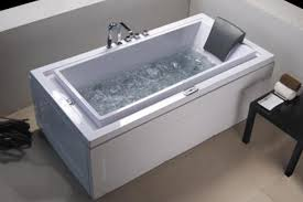 extraordinary stand alone jetted tub rectangular white standalone jacuzzi with chrome faucet next to small black