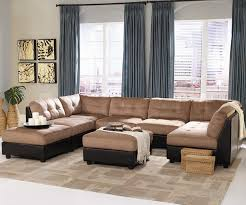 furniture mocha fabric sectional sofa set on beige rug connected by blue fabric curtains on
