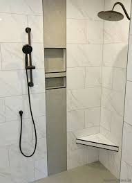 Tiled shower in Quad Cities area home by Hazelwood Homes with design ...