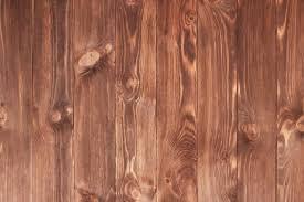 dark brown scratched wooden cutting board wood texture