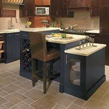 Kitchen With Blue Island And Base Cabinets