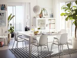 Black and white chairs living room Ikea Light Dining Room Furnished With Large White Table And Four White Chairs With Chrome Shutterfly Dining Room Furniture Ideas Ikea