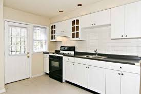 Kitchen Cabinet For Sink Picture Of White Kitchen Cabinet With Black Countertop With Sink Top
