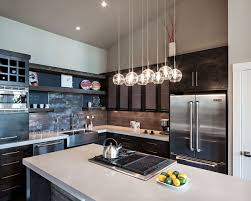 kitchen islands lighting. Modern Kitchen Island Lighting Features L Shaped Black Cabinet Along With Sink Refrigerator And Oven Islands