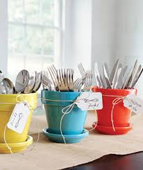 Clever idea for entertaining. Use unused flower pots for silverware holders.  Adds a nice pop of color to the buffet.