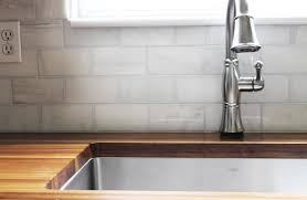 leaving our friends and leaving the marble backsplash tears with the tile finished the kitchen is a