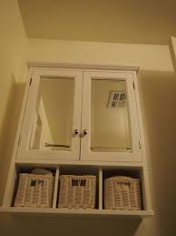 cabinets over toilet in bathroom. white baskets. yum bathroom cabinets over toilet storage   french in