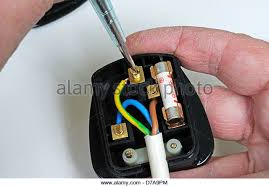 three pin plug stock photos three pin plug stock images alamy man wiring english 3 pin 13 amp plug inserting earth wire england uk