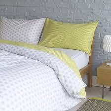 with complementary patterns and a contemporary colour palette the reversible ditsy grey and yellow reversible kingsize duvet cover set gives a bedroom a