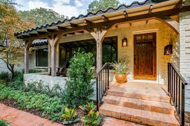 omaha glass pro ideas for mediterranean exterior with porch bark ground cover front porch with pillar and painted white brick exterior