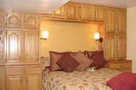 bedroom Attractive Cream Wooden Cabinets Beside Also Luxury Wall