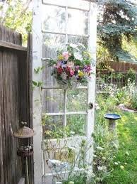 the old door for garden decor could see using two to major a trellis of sorts