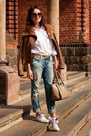 women s white low top sneakers blue ripped boyfriend jeans white dress shirt leather biker jacket women s fashion lookastic uk