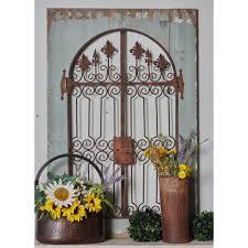 litton lane iron distressed brown scrollwork and fleur de lis finial gate metal work