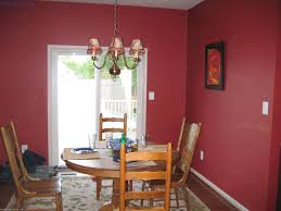 astounding red wall painted with rounded wooden dining table set also classic shade chandelier as inspiring vintage small red dining room decors