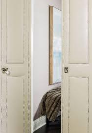 leather bi fold doors with nailhead trim