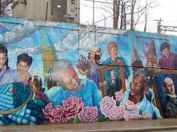 Artists Olivia Gude, Marcus Akinlana, and Jon Pounds collaborated with  local community members to create this mural. It was designed to unite the  ...