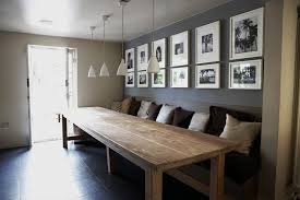 large dining table. Large Dining Table With A Built In Bench And Wall Behind Decorated Pics
