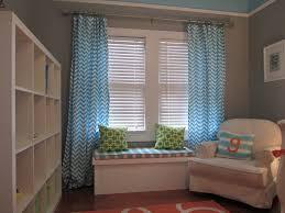 image of orange round nursery rugs
