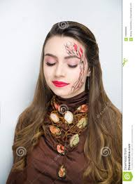 creative make up brown tree of life has taken root lines abstract long branches and leaves are spread out on s forehead soul on fire nature concept