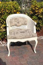 vintage french provincial cane barrel chair with tufted back hand painted in a decorative paint