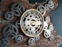 large wall clock with rotating gears