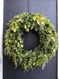 This modern Chartreuse wreath is prelit and filled with chartreuse green  berries, fern, and silk leaves. This wreath measures 20 inches wide,