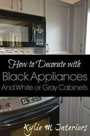 black appliance matte seamless kitchen: black appliances decorating ideas in a kitchen with gray or white cabinets