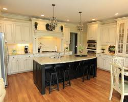 Cream Colored Kitchen Cabinets And Washable Rugs With Garden Window