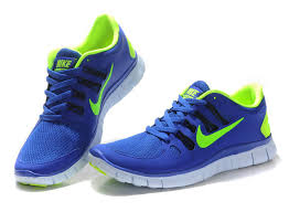 nike running shoes. blue and lime green nike running shoes