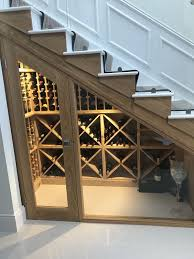 a small wine cellar with glass doors and wooden shelves for storage doesn t require