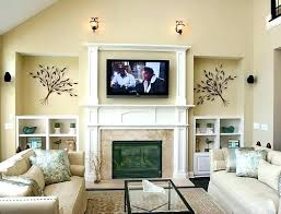 stacked stone fireplace with tv above wall mount over how to television best for a yelp