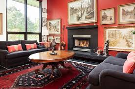 beautiful framed wall art and the bold rug steal the show here design natural
