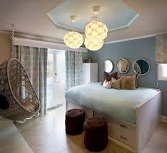 alluring small bed inside large window and hanging chair for bedroom plus chic lamp