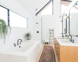 Example of a trendy master white tile beige floor and light wood floor  bathroom design in
