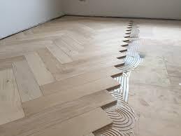 wood flooring with underfloor heating designs