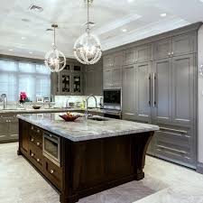 a pair of crystal orb chandeliers make a great statement over this large island