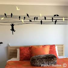 cat chasing birds on a wire wall decal