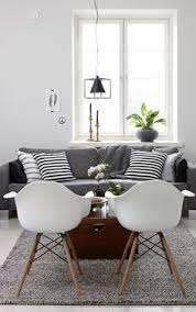 lovely living room with fantastic white chairs and a fy grey couch love this scandinavian