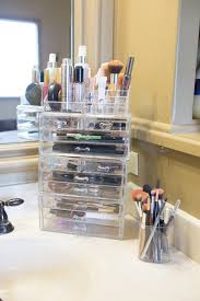 get acrylic organizers with drawers this will make you have all of your makeup in arm s reach while also being able to see inside of them