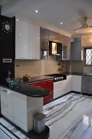 u shaped kitchen with modern cabinets and wall decor
