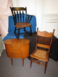 item 16 hitch rocking chair vintage sewing cabinet and oak pressed back chair with cane seat seat needs repair items appearing in backgrounds