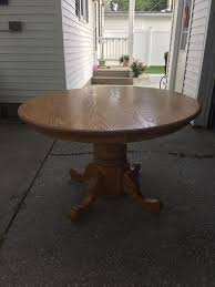 amish round oak dining table