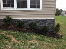 fake outdoor stone siding. fake stone foundation covering makes an elegant front garden accent. veneer exteriorfaux outdoor siding