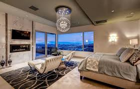 inspiring relaxing bedroom chairs design a contemporary master bedroom with modern globe chandelier fireplace carpet and amazing views jpg
